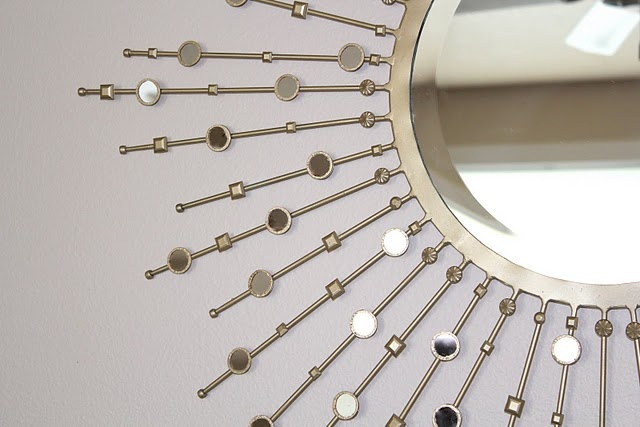 Embellished sunburst mirror with craft mirrors and scrapbooking bling.