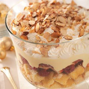 Old English Trifle Recipe from Taste of Home. I would omit the sherry and brandy, use ladyfingers and macaroons, & layer it. Love how the topping looks.