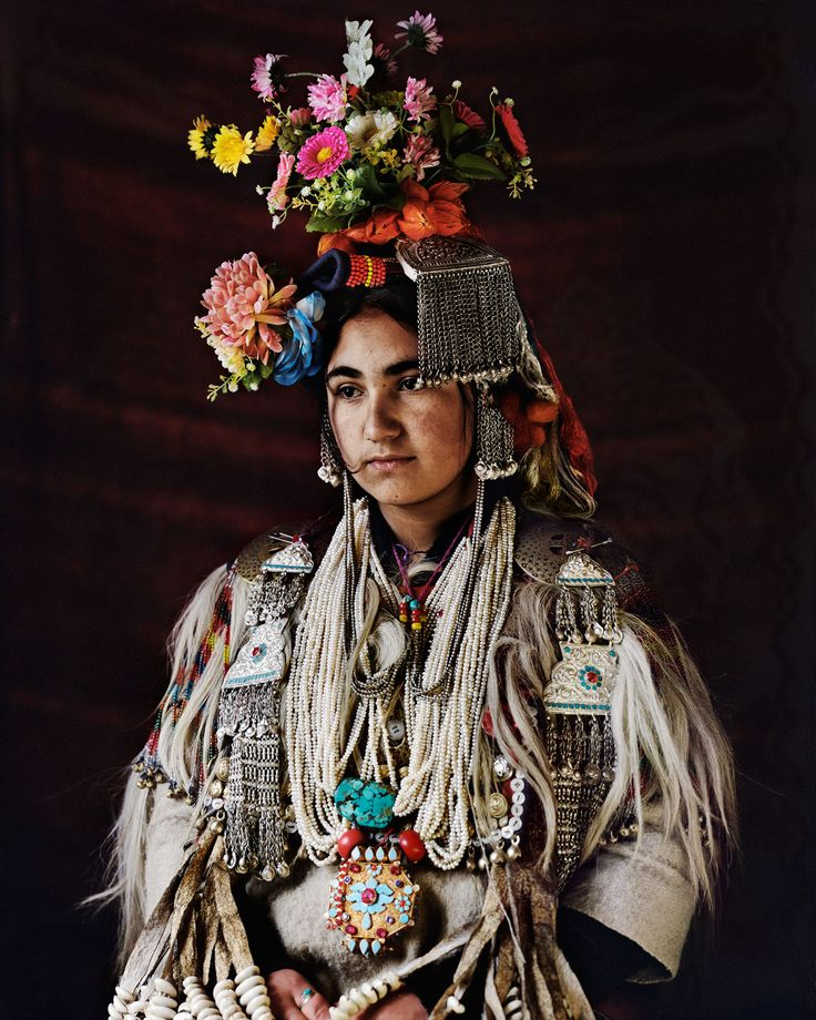 Asia | Portrait of a Drokpa woman wearing traditional clothes, headdress and silver jewelry, Ladakh, India | © Jimmy Nelson