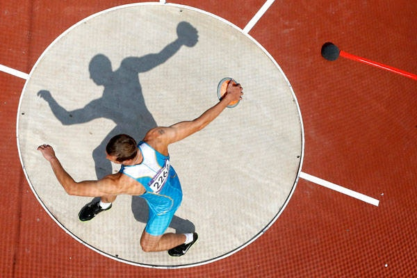 Kazakhstan's Dmitriy Karpov competes in the men's decathlon discus throw event.  Good photo - would be cool to get a shot like this of Noah.