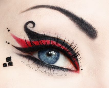 Harley Quinn makeup - nice. I think the level of skill in these types of things is making eye makeup symmetrical.