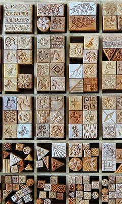 Wooden stamps for making repeating patterns in surface decoration.