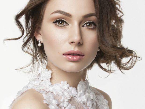 A thick flick of eyeliner and dusky pink lips are a classic bridal beauty look for this season.