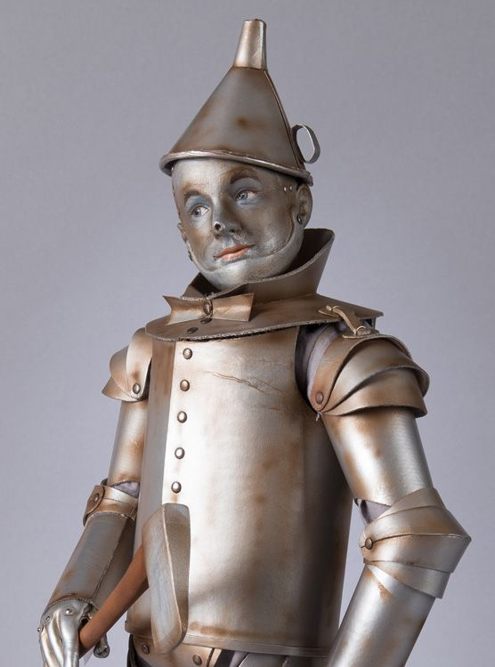 The Tin Man is important to me because I've researched and written a book on metal dolls and their place in culture, but through the years, I have picked up vintage Mego dolls of the characters, plush, Alexander versions, Mattel versions, glass ornaments, you name it. I even have a tiny cloth Dorothy and Toto in a basket signed by two of the actors who played the Munchkins.  18″ R. John Wright Tin Man from The Wizard of Oz