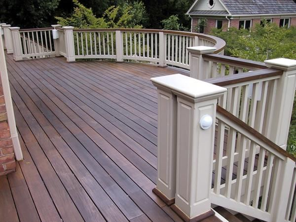 dark wood deck and railing top and white rails and posts