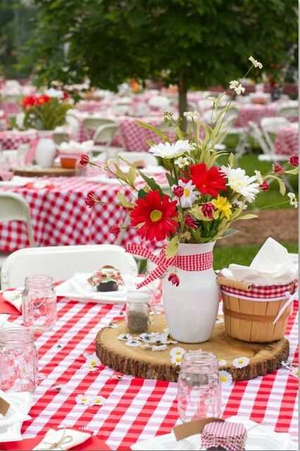 Red and white gingham with wildflower centerpiece for a rustic barn country wedding