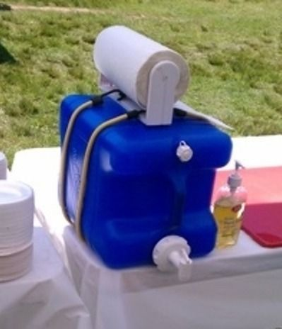 Save an old laundry soap container and fill with water. Bungee cord a roll of paper towels w/ plastic holder on top and use as a portable hand washing station.