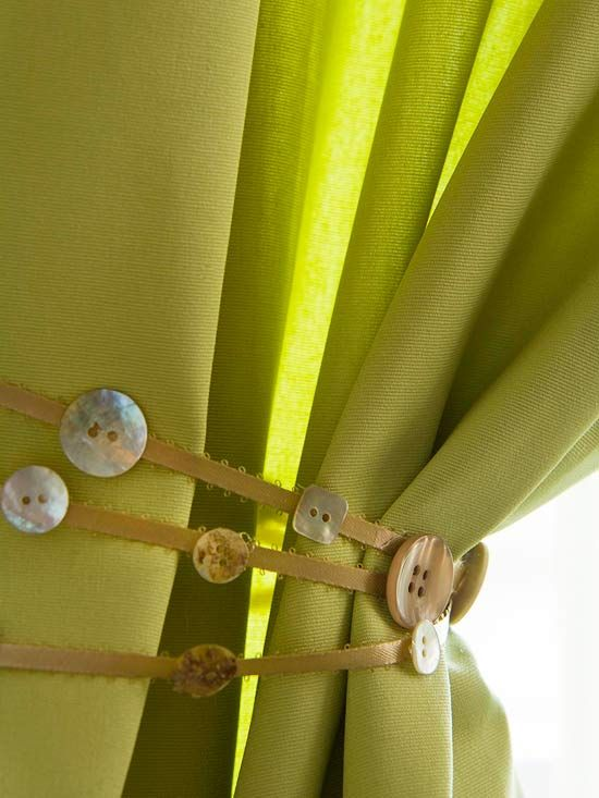 Creative Curtain Draw  An older child will love designing a creative curtain draw. Have her choose a ribbon. Cut it so it's long enough to wrap about the curtain several times and tie in a bow. Before tying around the curtain, attach buttons to the ribbon using hot glue.