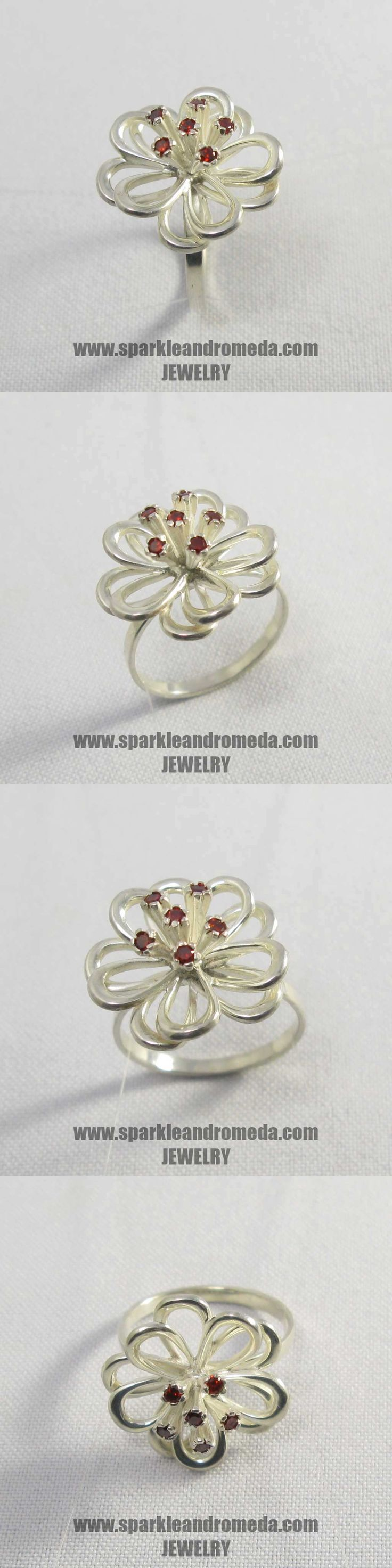 Sterling 925 silver ring with 6 round 2 mm red almandine color cubic zirconia gemstones.