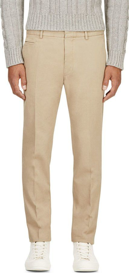 Beige Chinos by Maison Martin Margiela. Buy for $288 from SSENSE