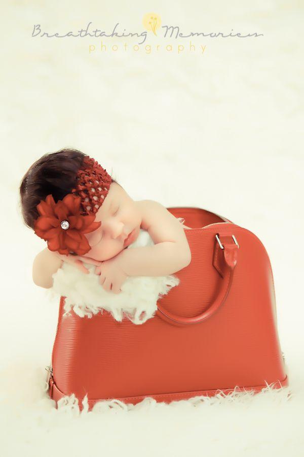 Newborn Baby Girl Inside A Louis Vuitton Red Purse
