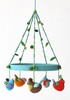 What a cute little mobile to hang over the dressing table... or a book nook... knit it up!