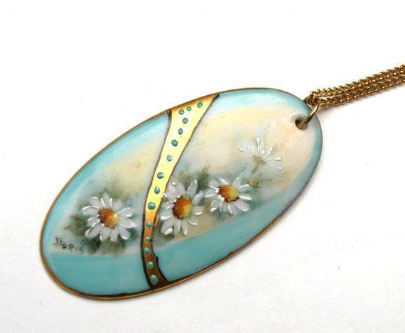 Blue porcelain pendant with gold leaf.