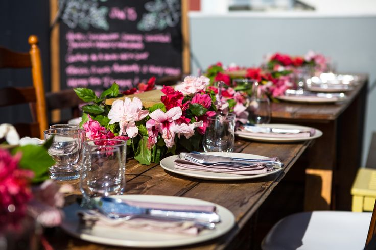 Summer hibiscus hedge tablescape for a tropical rooftop dinner party   Styled by The Inventory for The Lazy Susan Lunch Club, January Rooftop Dinner Party 2015 #hibiscus #tropical #tablescape #pink #rooftop
