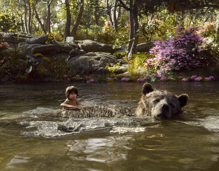 jungle book mowgli swimming | The Jungle Book: Bagheera and Mowgli swim across a river | The cast of ...