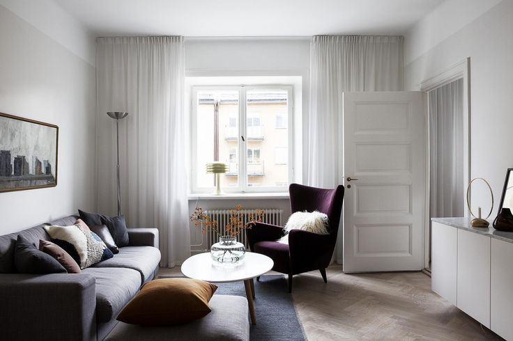 Beautiful apartment in grey, purple & mustard