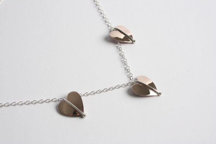 A very pretty three leaf necklet created in bronze with silver vein on silver trace chain.  #bronze #heart #necklace #pendant #silver #jewellery #cornwall #uk #gb #westcountry #devon #england #silversmith #pretty #jeweller #jewellers #handmadejewellery #handmade