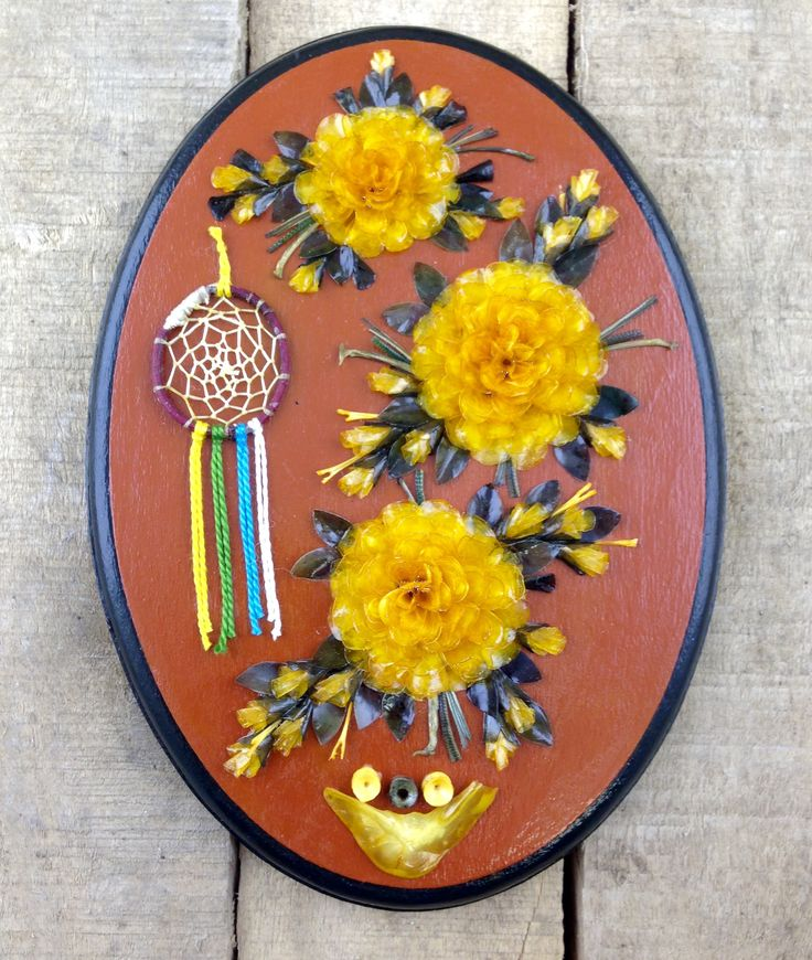 Every scale in this gorgeous, yellow-themed Fish scale wall hanging was individually hand-dyed and meticulously arranged to create this exquisite piece of art. This piece in particular also features a mini dreamcatcher. #Esawa #FishScaleArt #Handmade #DreamCatcher