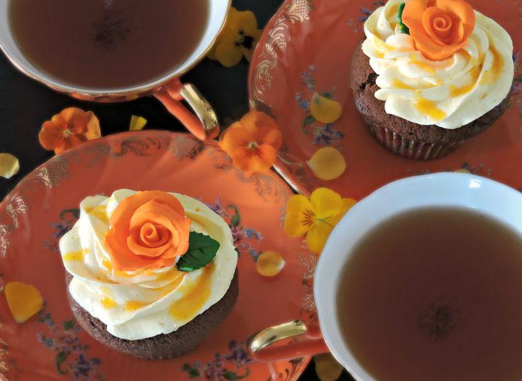 Tonka bean/chocolate cupcakes topped with mandarin buttercream, mandarin sauce and handmade sugar rose. Amazing flavour combination.