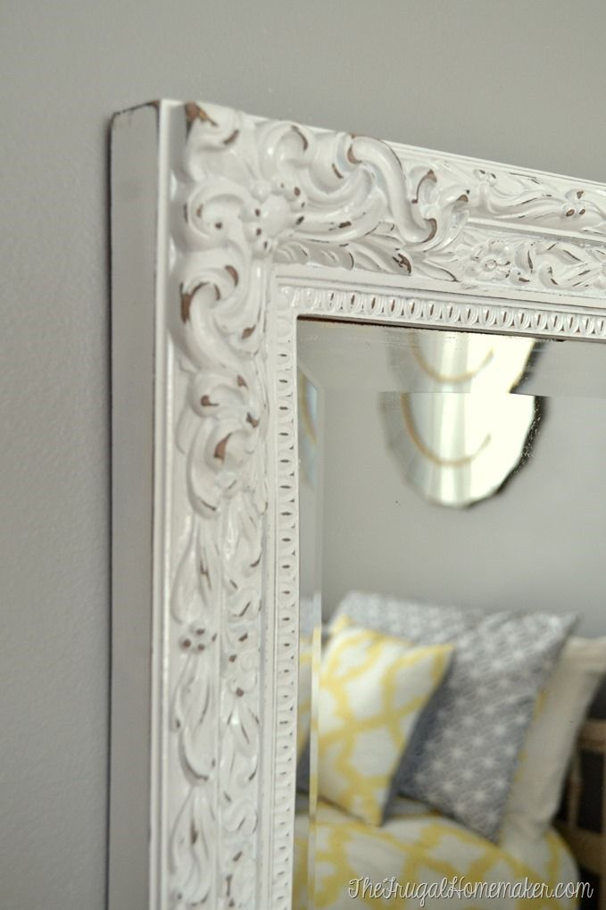 Painted and distressed yard sale mirror with @rustoleum spray paint: