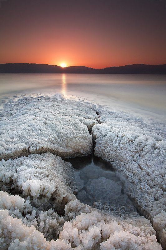 The Dead Sea- bordering Israel the West Bank and Jordan- Is a lake who's banks are made more than 429m below Sea level (1,407 ft.) The lowest point on dry land. It's famously hyper-saline water makes floating easy and its mineral-rich black mud is used for therapeutic and cosmetic treatments at areas resorts. The dead Sea Earth's lowest elevation on land. #LandscapeSea