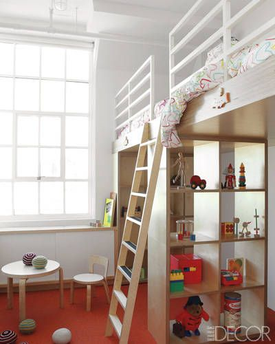 This lofted bed creates a fun play space for a child in this Tribeca loft. -only problem is that if they are small enough for the table and chairs in the room then they are too small to be up so high. :-o