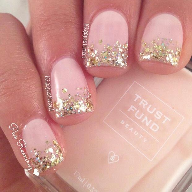 Cute pink nails with golden glitter