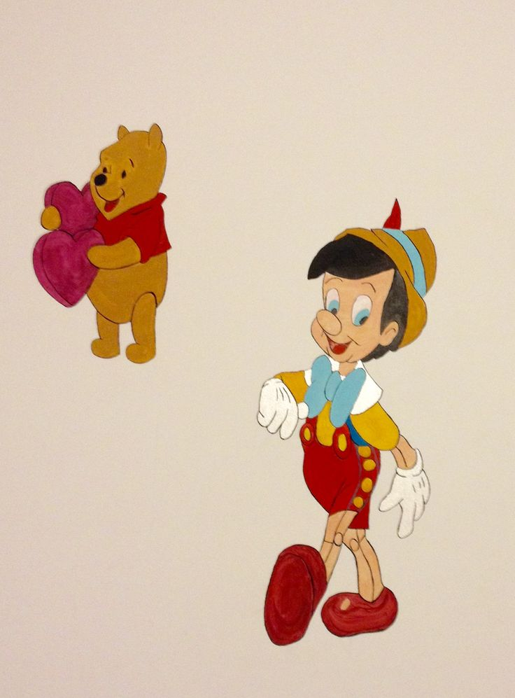 Free-hand painting on a nursery wall_Winnie & Pinocchio