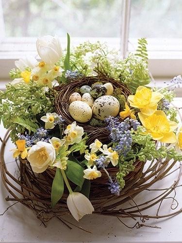 grapevine wreath, loosen a bit, tuck in the beautiful flowers, add eggs maybe a ribbon. Pretty centerpiece