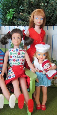 Skipper, Skooter and Tutti My sister and I had Tutii, Barbies little sister, but they were in awful shape, and the outfits too, but I remember the cute sailor outfits!