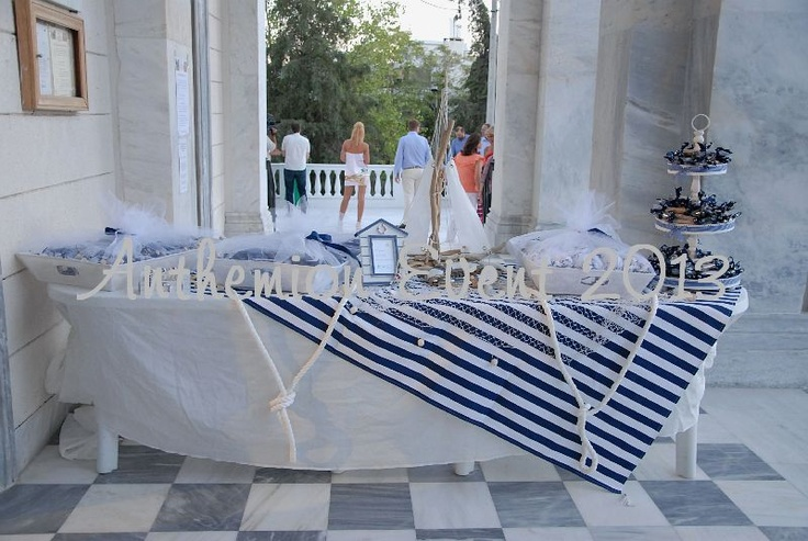 Baptism table with baptism favors and sweets for guests.