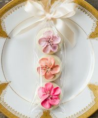 FLORAL SUGAR COOKIE FAVOURS -  OUR HAND PIPED FLORAL SUGAR COOKIE FAVOURS ADD THE FEELING  OF AN ENGLISH GARDEN IN BLOOM TO ANY SPECIAL EVENT.