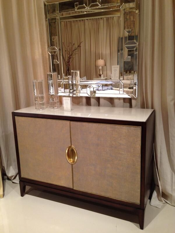 The backpainted glass top on caracole furnitures credenza is practical and a nice textural foil to the front panels