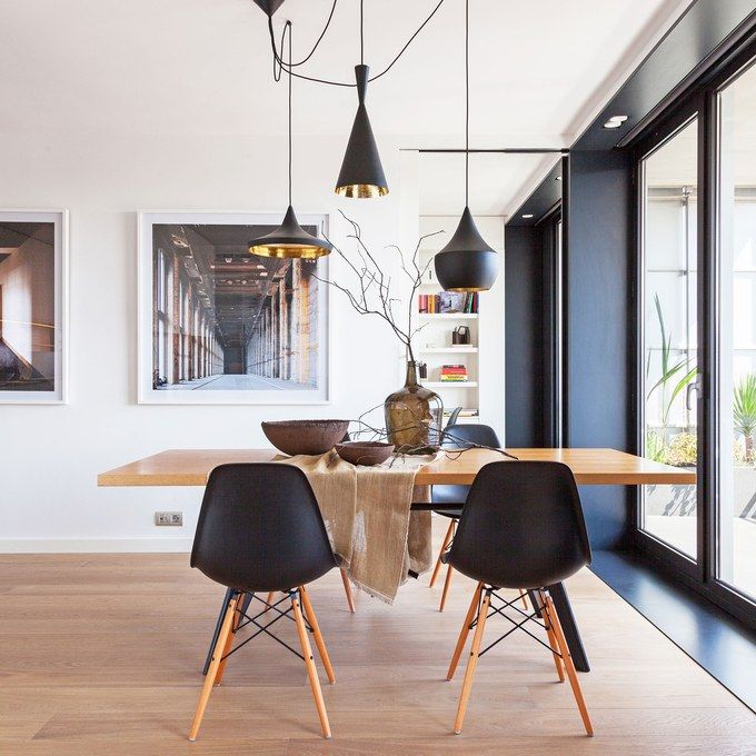 Beat pendants by Tom Dixon hang above midcentury-style furnishings in the dining room.  Photo: Courtesy of YLab Arquitectos