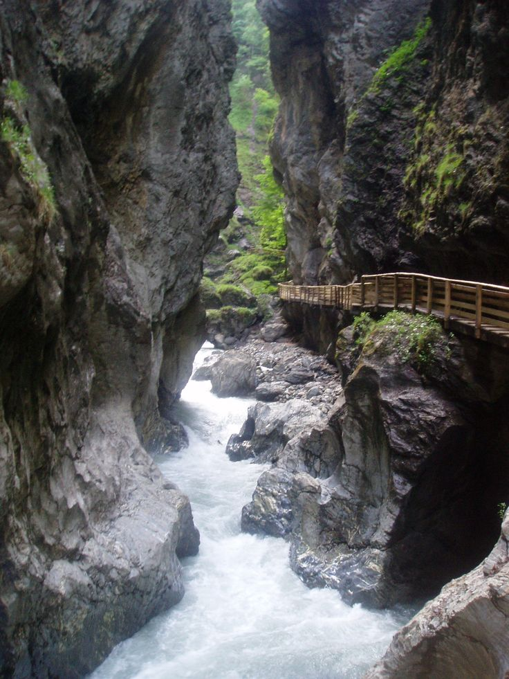 Liechtenstein Klamm, Austria. A narrow gorge that has walls that are 985ft high and a walkway that is 2 miles long. The gorge is south of Salzburg.