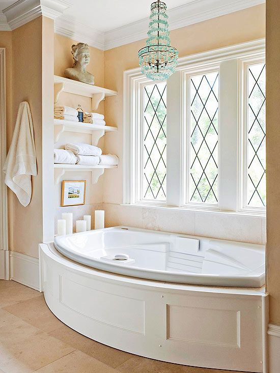 A whirlpool tub is bathed in natural light by a trio of large Art Deco-style windows. The panes boast an X motif that lends subtle decorative appeal.