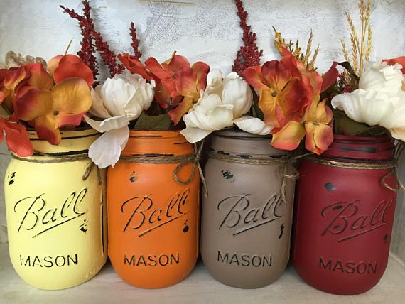 We are so excited that its time for the beautiful fall colors. We have hand painted and distressed our Mason Jars in an array of colours that will enhance your fall decor, Thanksgiving decor, or fall wedding. Each jar has been sealed and tied with twine and are painted on the outside allowing them to hold water. The jars should not be submerged in water. To clean simply wipe with a damp cloth. This set includes 4 pint size Ball Mason Jars in dark yellow, pumpkin spice, brown and deep red…