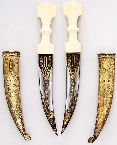 Arabian jambiya, 19th century, steel, ivory, gold, wood, glass, H. with sheath 12 3/4 in. (32.4 cm); H. without sheath 12 1/16 in. (30.6 cm); W. 1 13/16 in. (4.6 cm); Wt. 8.4 oz. (238.1 g); Wt. of sheath 14 oz. (396.9 g). Met Museum.