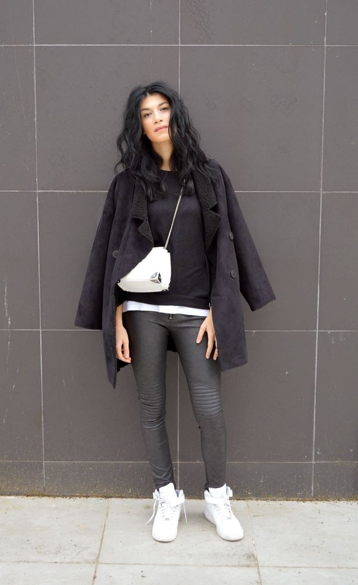 Shop this look on Lookastic:  http://lookastic.com/women/looks/shearling-coat-crossbody-bag-high-top-sneakers-crew-neck-sweater-crew-neck-t-shirt-skinny-pants/5667  — Black Shearling Coat  — White Leather Crossbody Bag  — White Leather High Top Sneakers  — Black Crew-neck Sweater  — White Crew-neck T-shirt  — Black Leather Skinny Pants