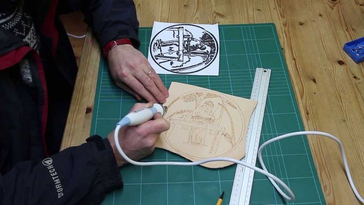 Using a woodburning / pyrography pen to burn a design onto vegetable tan leather.