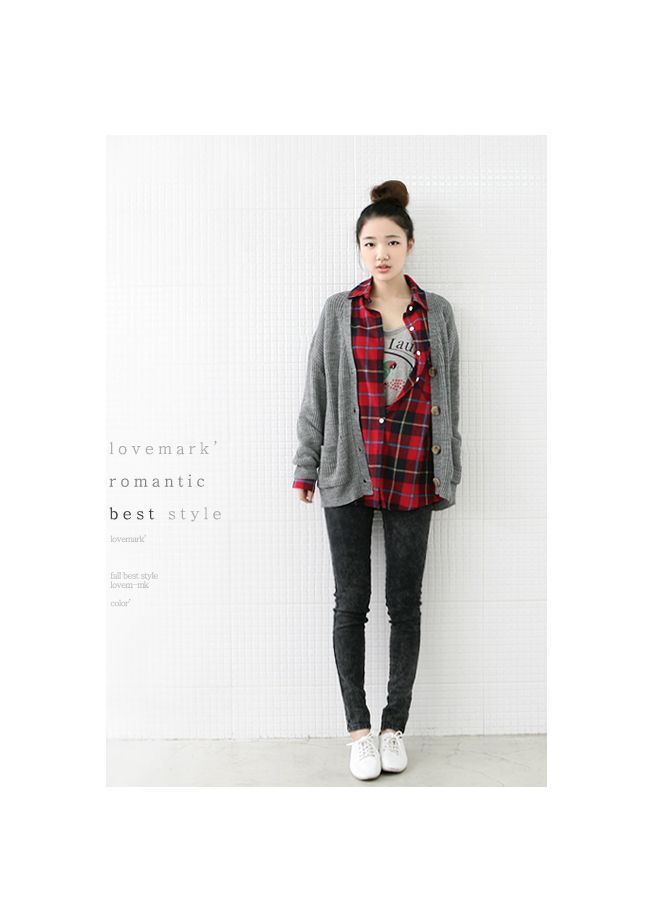 Gray printed t-shirt with a red flannel shirt and a grey cardigan and black skinny jeans and white shoes