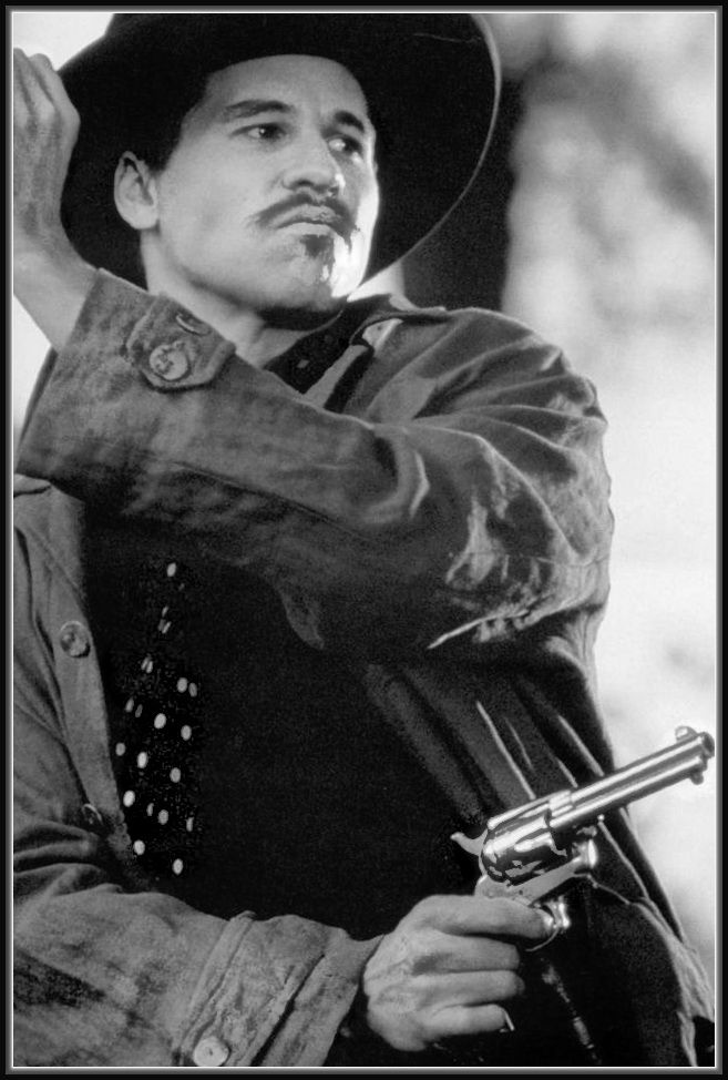 Val Kilmer [b1959] - Tombstone is a 1993 American western film directed by George P. Cosmatos, written by Kevin Jarre and starring Kurt Russell and Val Kilmer, with Sam Elliott, Bill Paxton, Powers Boothe, Michael Biehn, and Dana Delany, in supporting roles, as well as a narration by Robert Mitchum.