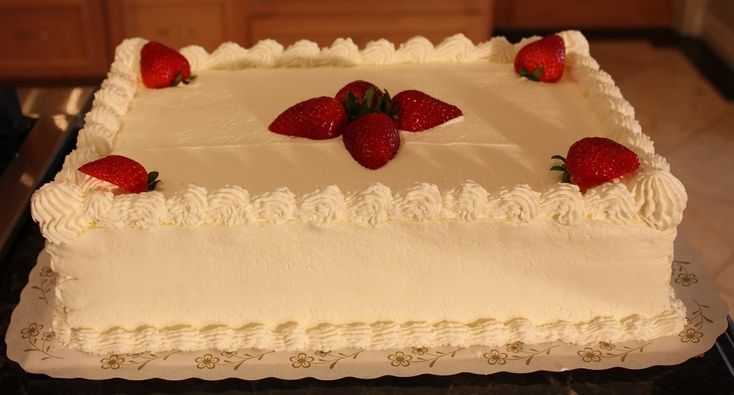 White sheet cake with strawberries and whip cream decoration....good recipe for whip cream frosting
