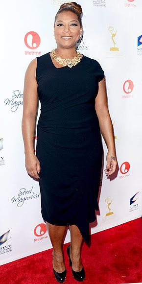 More like Grandma LATIFAH! The severe hair in a bun is killing this look. Go for sexy long hair or shorten the dress my Queen you can do better than this girl!