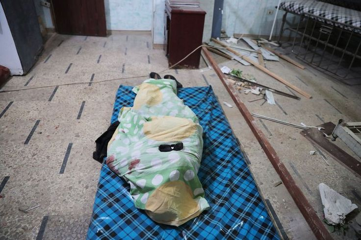 The body of a 15-year-old girl at a makeshift morgue on Thursday in the rebel-held town of Douma, Syria, on the outskirts of Damascus, after reports of airstrikes. Credit Abd Doumany/Agence France-Presse — Getty Images