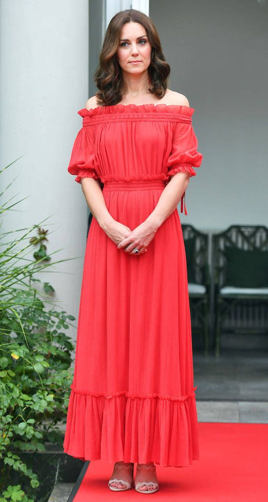 Casual Kate from Fashion Police Kate Middleton lets her hair down—both literally and figuratively—for the Queen's birthday celebration in Berlin, Germany. Catherine surprises everyone in a breezy, off-the-shoulder Alexander McQueen maxi styled with Prada scalloped sandals and Simone Rocha earrings. It's refreshing to see the Duchess take such a casual approach for once, especially in this vibrant hue.