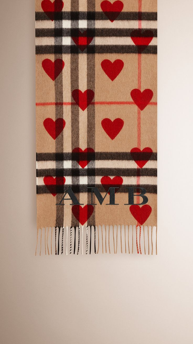 Burberry Parade Red The Classic Cashmere Scarf in Check and Hearts - The Classic Cashmere Scarf in check with heart print is made at a 200-year-old mill in the Scottish countryside. Using 30 different steps, the scarf is woven on traditional looms. Discover the scarves collection at Burberry.com