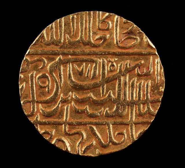 """With the Arabic language forming a common bond among Islamic cultures, Arabic script became the principal element on gold coins like these, which represented the authority of the Islamic dynasties. Upon ascending to the throne, each ruler affirmed his new power and status by having a coin struck in his name. In addition to the king's name, these coins also carry the profession of faith: """"There is no God but God and Muhammad is the Prophet of God.""""India. 1563 A.D"""
