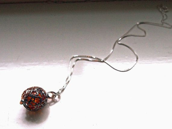 Check out this item in my Etsy shop https://www.etsy.com/uk/listing/236038505/fireball-sterling-silver-and-amber