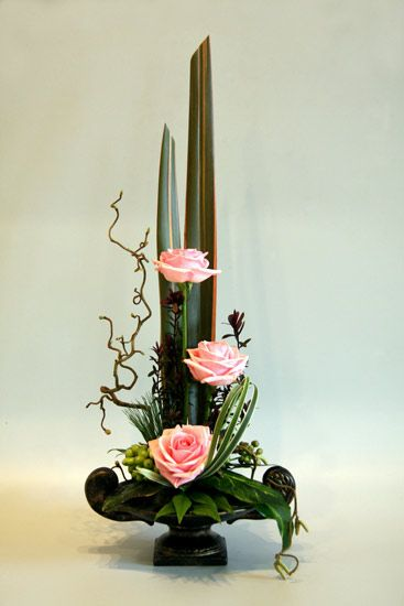 This arrangement uses only three flowers, and some interesting foliage and berries.